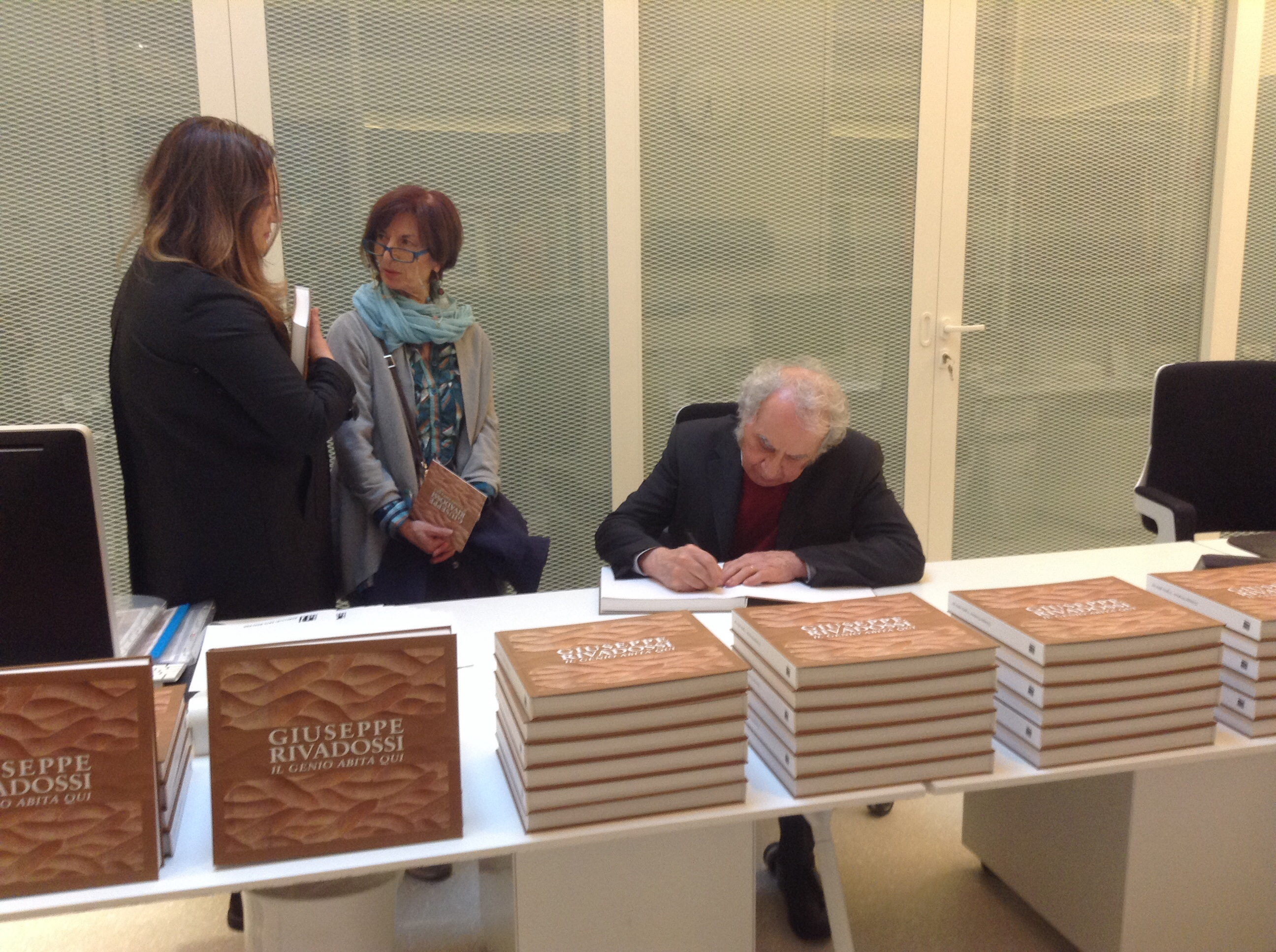 Giuseppe Rivadossi signing catalogues